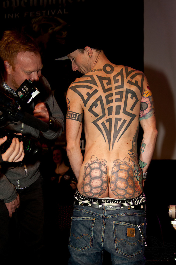 Snapshots from the Ink Festival in Copenhagen April 2011. Tree days of tattoo, tattooing and shows. Tattoos from the weird tattoo contest. This young man had two turtles on his buttocks.