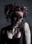 A conceptual image of a woman with a burnt face