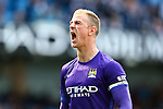 Joe Hart of Manchester City celebrates his sides second goal during the Barclays Premier League match at the Etihad Stadium. Photo credit should read: Philip Oldham/Sportimage