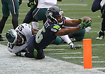Seattle Seahawks Wide receiver Tyler Lockett (16) reaches for the pylon after being taken out of bounds by  Philadelphia Eagles linebacker Nigel Bradham (53) after catching a 30-yard pass from Russell Wilson at CenturyLink Field in Seattle, Washington on November 20, 2016.  Seahawks beat the Eagles 26-15.    ©2016. Jim Bryant Photo. All Rights Reserved.