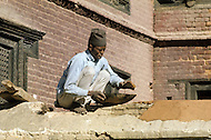 February 1975, Pokhara area, Nepal. Daily life. Street scene of construction worker.