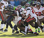Seattle Seahawks Running back Robert Turbin  is grabbed by Tampa Bay Buccaneers linebacker Adam Haywood (57, defensive back Keith Tandy (37)  in the second quarter at CenturyLink Field in Seattle, Washington on  November 3, 2013.  The Seahawks beat the Buccaneers 27-24 in overtime. ©2013. Jim Bryant. All Rights Reserved.