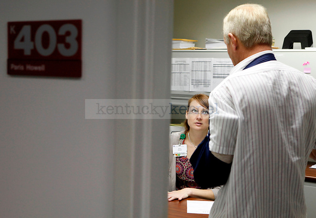 """Paris Howell, aka """"Ellie Slay,"""" meets with a patient, Ovie Nealis, in her office at the Kentucky Clinic on Oct. 28, 2009..Photo by Zach Brake 