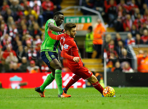 25.10.2015. Anfield, Liverpool, England. Barclays Premier League. Liverpool versus Southampton. Liverpool's Adam Lallana shields the ball from Southampton's Victor Wanyama.