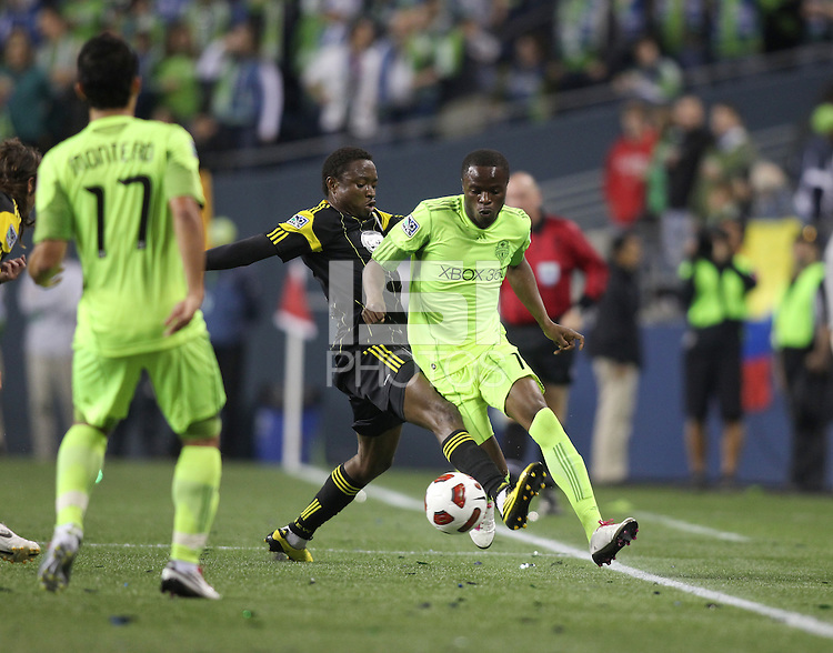 Steve Zakuani (11)of the Seattle Sounders FC runs past Emmanuel Ekpo (17) of the  Columbus Crew . The Seattle Sounders FC defeated the Columbus Crew 2-1 during the US Open Cup Final at Qwest Field in Seattle,WA, on October 5, 2010.
