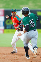 Greensboro Grasshoppers shortstop Rehiner Cordova (1) looks to make a throw to first base as Eliezer Zambrano (5) of the Augusta GreenJackets runs towards second base at NewBridge Bank Park on August 11, 2013 in Greensboro, North Carolina.  The GreenJackets defeated the Grasshoppers 6-5 in game one of a double-header.  (Brian Westerholt/Four Seam Images)