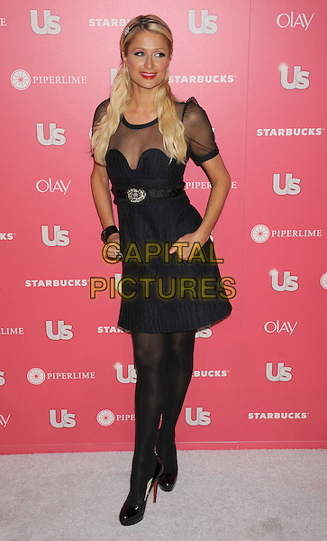 PARIS HILTON.The Us Weekly Hot Hollywood Party at Eden in Hollywood, California, USA..April 26th, 2011.full length dress hands on hips hairband black sheer mesh see thru through tights shoes patent brooch navy blue  .CAP/ROT/TM.© TM/Roth/Capital Pictures