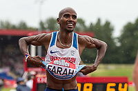 Mo FARAH of Great Britain removes his shirt after his final track race in the UK ever (3000m) during the Muller Grand Prix Birmingham Athletics at Alexandra Stadium, Birmingham, England on 20 August 2017. Photo by Andy Rowland.