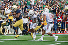 Sept. 26, 2015; Quarterback DeShone Kizer heads to the end zone for a first quarter touchdown against the University of Massachusetts. (Photo by Barbara Johnston/University of Notre Dame)
