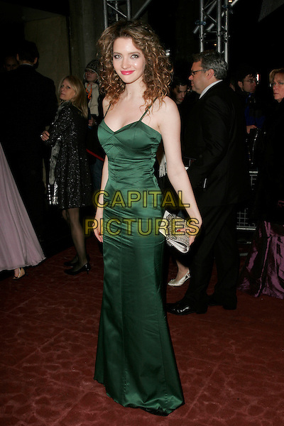 TALULAH RILEY.The Orange British Academy Film Awards 2009 Soho House Grey Goose After Party at the Grosvenor House Hotel, London, England. .February 8th, 2009 .bafta baftas full length long maxi dress clutch bag silk satin green tallulah.CAP/AH.©Adam Houghton/Capital Pictures.beard.