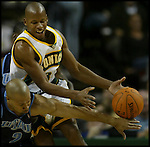 Utah Jazz' Carlos Boozer, left, knocks the ball away from Seattle SuperSonics' Ray Allen in NBA basketball action in the second period Friday, Nov. 17, 2006 in Seattle. (AP Photo/Jim Bryant)