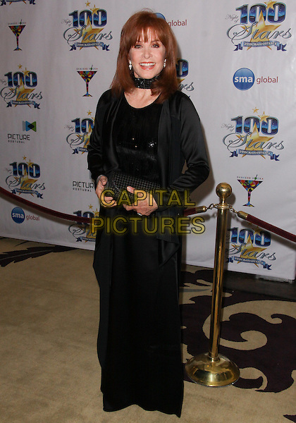 STEPHANIE POWERS .Night of 100 Stars - Arrivals held at the Beverly Hills Hotel, Beverly Hills, California, USA..March 7th, 2010.full length black jacket dress clutch bag .CAP/ADM/TC.©T. Conrad/AdMedia/Capital Pictures.