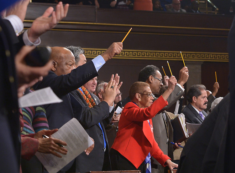 US lawmakers pay tribute to the victims of the Paris attacks by holding up pencils during the State of the Union address by US President Barack Obama, before a joint session of Congress on January 20, 2015 at the US Capitol in Washington, DC.  <br /> Credit: Mandel Ngan / Pool