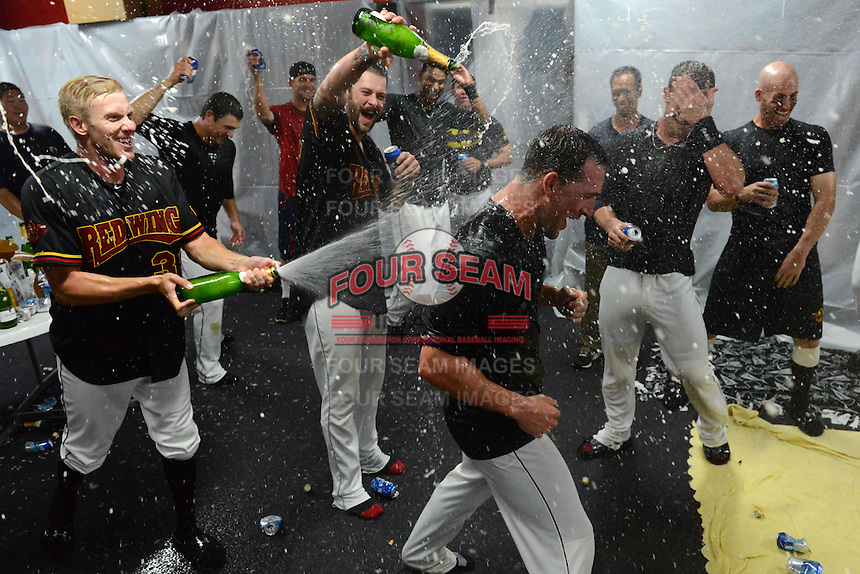 Rochester Red Wings pitchers Cole De Vries, Aaron Thompson and outfielders Brian Dinkelman, Dan Rohlfing celebrate in the locker room after defeating the Scranton Wilkes Barre RailRiders on September 2, 2013 at Frontier Field in Rochester, New York to clinch the International League Wild Card Playoff spot.  (Mike Janes/Four Seam Images)