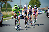 riders returning through the team cars (to the peloton) after a nature-break<br /> <br /> Eneco Tour 2013<br /> stage 1: Koksijde - Ardooie (175km)