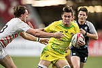 Harry Glover of England (left) tries to stop Lachie Anderson of Australia (center) who runs with the ball during the match Australia vs England, the Bronze Final of Day 2 of the HSBC Singapore Rugby Sevens as part of the World Rugby HSBC World Rugby Sevens Series 2016-17 at the National Stadium on 16 April 2017 in Singapore. Photo by Victor Fraile / Power Sport Images
