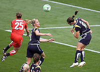 LA Sol's Brittney Bock (l) and Allison Faulk (r) battle with Washington Freedom's Claire Zimmeck (25). The LA Sol defeated the Washington Freedom 2-0 in the opening game of Womens Professional Soccer at Home Depot Center stadium on Sunday March 29, 2009.  .Photo by Michael Janosz