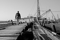 James Brown walks along the dock at Backman's Seafood in the community of  Sol Legare on James Island near Charleston SC.