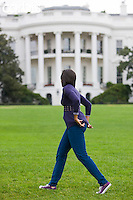 "29 Oct 2009, Washington, DC, USA --- ""First lady Michelle Obama walks back to the White House after harvesting vegetables from the Kitchen Garden on the South Lawn.                                        "" --- Image by © Brooks Kraft/Corbis"