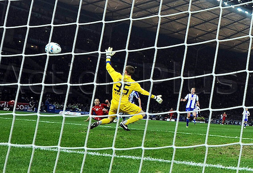 17.03.2012. Berlin, Germany.  Hertha BSC Berlin versus FC Bayern Munich. Arjen Robben Bayern Munich scores the goal for 2-0 past Goalkeeper Thomas Power Hertha BSC