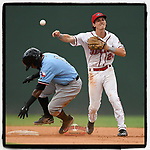 Shortstop Ryan Fitzgerald (24) of the Greenville Drive throws to first after making the putout on Yonny Hernandez (1) of the Hickory Crawdads in Game 2 of a doubleheader on Wednesday, July 25, 2018, at Fluor Field at the West End in Greenville, South Carolina. Hickory won, 7-1. (Tom Priddy/Four Seam Images)