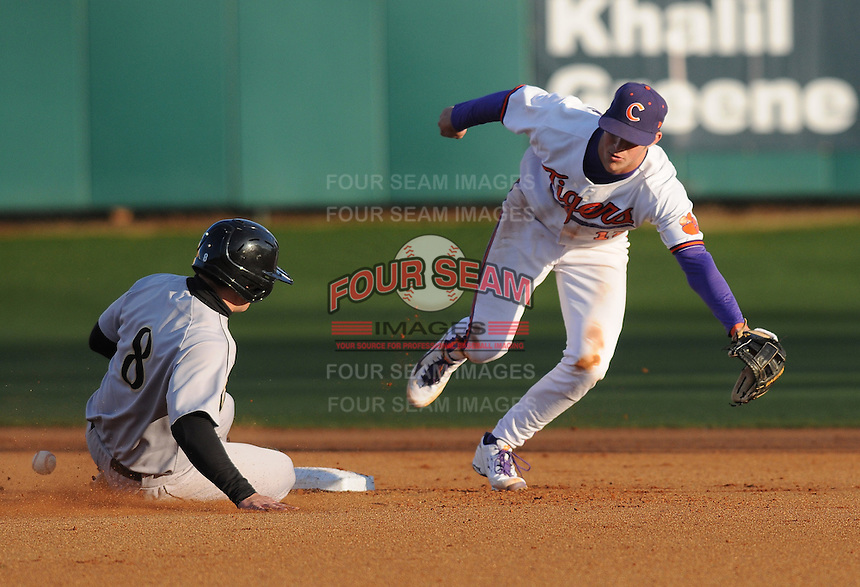 Seth Neely (8) of the Wofford Terriers steals second base with second baseman Steve Wilkerson (17) of the Clemson Tigers defending in the sixth inning of a game on Wednesday, March 6, 2013, at Doug Kingsmore Stadium in Clemson, South Carolina. Clemson won, 9-2. (Tom Priddy/Four Seam Images)
