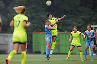 eattle, WA - Sunday, May 22, 2016: Seattle Reign FC midfielder Keelin Winters (11) goes up for a header with Chicago Red Stars midfielder Taylor Comeau (7) during a regular season National Women's Soccer League (NWSL) match at Memorial Stadium. Chicago Red Stars won 2-1.