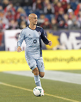 Sporting Kansas City defender Aurelien Collin (78) brings the ball forward.  In the first game of two-game aggregate total goals Major League Soccer (MLS) Eastern Conference Semifinal series, New England Revolution (dark blue) vs Sporting Kansas City (light blue), 2-1, at Gillette Stadium on November 2, 2013.