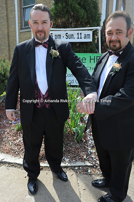 Daren Adkisson, 39, and Curtis Harris, 50, or Rock Island, Illinois outside the Metropolitan Community Church before their wedding in Davenport, Iowa on May 3, 2009. Adkisson and Harris picked up their marriage license early in the morning on April 27, the first day gay couples were eligible to marry in Iowa under a new law, and are getting married with seven other couples on the first Sunday after the passage of the new law.
