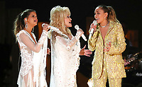 "Maren Morris, from left, Dolly Parton and Miley Cyrus perform ""After The Goldrush"" at the 61st annual Grammy Awards on Sunday, Feb. 10, 2019, in Los Angeles. (Photo by Matt Sayles/Invision/AP)"
