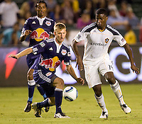 Defender Tim Ream of the New York Red Bulls takes the ball away from LA Galaxy forward Edson Buddle. The New York Red Bulls beat the LA Galaxy 2-0 at Home Depot Center stadium in Carson, California on Friday September 24, 2010.