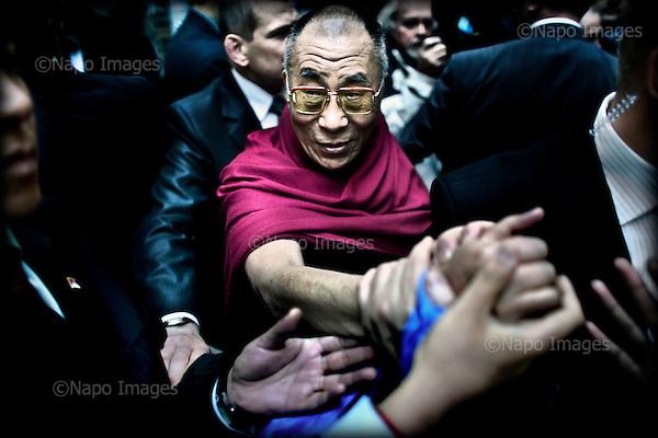 Wroclaw 10.12.2008 Poland<br /> His Holiness XIV Dalai Lama after press conference in Sofitel Hotel exchange greetings with His admirer.<br /> Continuing his tour of Poland, The Dalai Lama has met with journalists on press conference in Wroclaw before He will receive the honorary citizenship of Wroclaw.<br /> Photo: Adam Lach / Napo Images<br /> <br /> Jego Swiatobliwosc XIV Dalajlama po konferencji prasowej w Hotelu Sofitel wita sie ze swoimi wielbicielami.<br /> Kontynuujac swoja podroz po Polsce, Dalajlama spotkal sie z dziennikarzami na konferencji prasowej we Wroclawiu tuz przed tym jak otrzyma honorowe obywatelstwo Wroclawia.<br /> Fot. Adam Lach / Napo Images