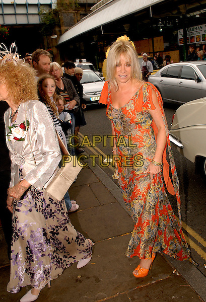 JO WOOD & GUEST .At the wedding of Leah Wood and Jack McDonald, Southwark Cathedral, London, England,.June 21st, 2008.marriage full length orange beige pattern dress long maxi white silk satin jacket purple .CAP/IA.©Ian Allis/Capital Pictures.