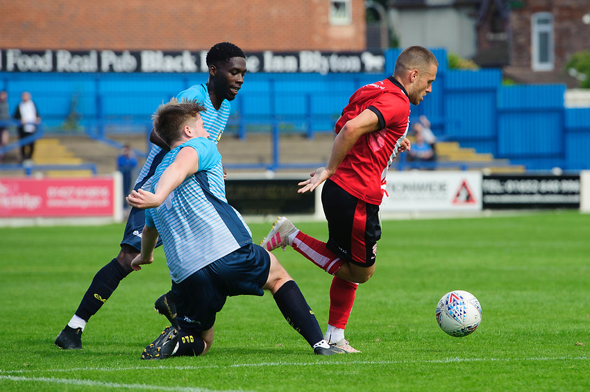 Lincoln City's Jack Payne vies for possession with Gainsborough Trinity's trialist<br /> <br /> Photographer Chris Vaughan/CameraSport<br /> <br /> Football Pre-Season Friendly (Community Festival of Lincolnshire) - Gainsborough Trinity v Lincoln City - Saturday 6th July 2019 - The Martin & Co Arena - Gainsborough<br /> <br /> World Copyright © 2018 CameraSport. All rights reserved. 43 Linden Ave. Countesthorpe. Leicester. England. LE8 5PG - Tel: +44 (0) 116 277 4147 - admin@camerasport.com - www.camerasport.com
