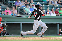 Outfielder Lewis Brinson (27) of the Hickory Crawdads bats in a game against the Greenville Drive on Friday, June 7, 2013, at Fluor Field at the West End in Greenville, South Carolina. Brinson is the No. 12 prospect of the Texas Rangers, according to Baseball America and was a first-round pick (29th overall) in the 2012 First-Year Player Draft. Greenville won the resumption of this May 22 suspended game, 17-8. (Tom Priddy/Four Seam Images)