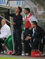 Fussball 1. Bundesliga 2011/2012  Testspiel   13.07.2011 Stuttgarter Kickers - VfB Stuttgart Trainer Bruno Labbadia (VfB Stuttgart)  mit  Co-Trainer Eddy Soezer (VfB Stuttgart) und  Manager Fredi Bobic (v.li, VfB Stuttgart)  nachdenklich.