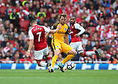 1st October 2017, Emirates Stadium, London, England; EPL Premier League Football, Arsenal versus Brighton; Dale Stephens of Brighton is tackled by Alexis Sanchez of Arsenal