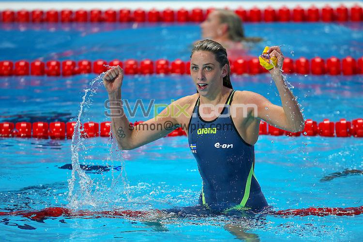 Picture by Alex Whitehead/SWpix.com - 09/08/2015 - Swimming - 16th FINA World Swimming Championships 2015 - Kazan Arena Stadium, Kazan, Russia - Sweden's Jennie Johansson celebrates winning Gold in the Women's 50m Breaststroke final.