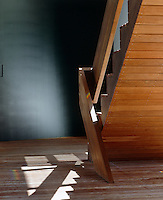 The simple central staircase, like much of the house, is made of timber