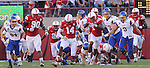LINCOLN, NE - SEPTEMBER 21, 2013:  Jonathon Rose #14 of Nebraska chases a loose football with teammates and other players from South Dakota State during their game Saturday at Memorial Stadium in Lincoln, NE.  (Photo by Dick Carlson/Inertia)