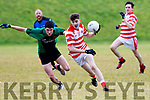 Jack O'Brien, Kilgarvan gets away from Mitchel Holland, Churchill during their Div 5 county league game at Churchill GAA ground last Saturday evening.
