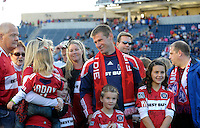 Chicago Fire forward Brian McBride (20) smiles as he waits with his family for a tribute from the Fire.  This game was McBride's last home game for the Fire.  The Chicago Fire tied DC United 0-0 at Toyota Park in Bridgeview, IL on Oct. 16, 2010.