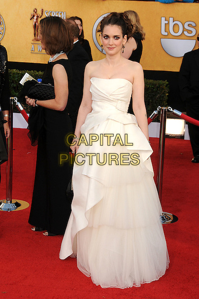 WINONA RYDER.17th Annual Screen Actors Guild Awards held at The Shrine Auditorium, Los Angeles, California, USA..January 30th, 2011.SAG arrivals full length white dress cream strapless gown maxi tiered ruffle folded layered black bag bracelet .CAP/ADM/BP.©Byron Purvis/AdMedia/Capital Pictures.