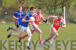 Daniel O'Shea,Ballymacelligott holds possession while Mike Finnegan&Tom McGolderick Brosna give Chase in their clash between the sides at the 1st round of the Junior County Championship last Sunday afternoon in Ballymac.