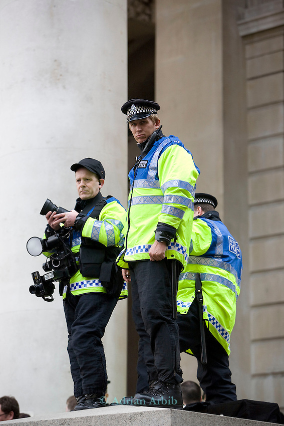Police fit  team.<br /> G20 meltdown protest outside the Bank of England. Thousands of protesters marched on the city of London during the G20 conference meeting  in London April 2009 , RBS  Bank windows were smashed on the ground floor. Police made around 90 arrests.