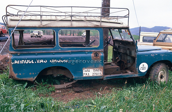 Spain 1990. Derelict spanish Land Rover Santana Series 3 109 Hard Top with full length roofrack. --- No releases available. Automotive trademarks are the property of the trademark holder, authorization may be needed for some uses. --- Info: From the mid 1950's untill the early 1990's the english Land Rover was also built under license in Spain. The spanish company Metalurgica de Santa Ana (later to become Santana Motor SA), was producing Land Rovers in the beginning from CKD kits, but local content was gradually increased until the Santanas (this is how they were called) were 100 per cent locally manufactured.