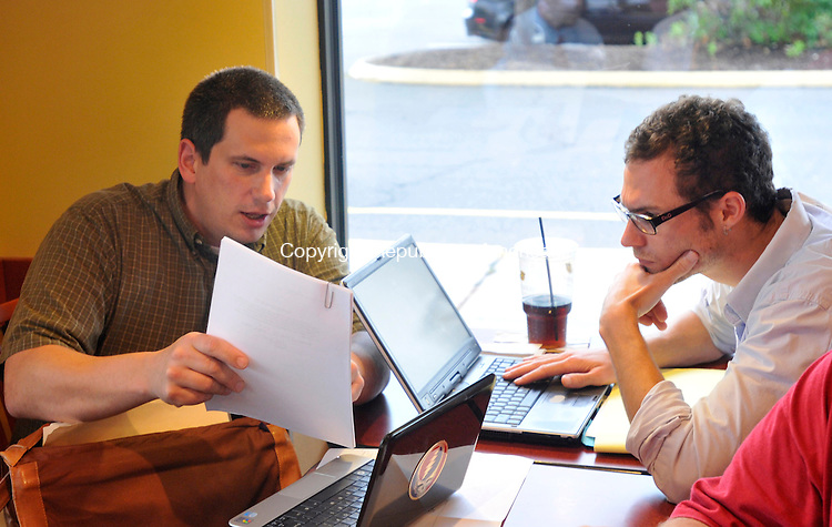 MERIDEN, CT-14 JULY 2010-071410IP03- Jeff Myer (left) of Middlebury and Wil Koch of Madison talk during a meeting of local hackers at Panera Bread in Meriden on Wednesday.                                                                                                                                                                                                                                                                                                                                                                                                                                                                                                                                                                                                                                                                                                                                                                                                           <br /> Irena Pastorello Republican-American