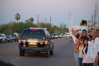 "Guadalupe, Arizona. April 3 and 4, 2008 - The Maricopa County Sheriff's Office (MCSO) led by Sheriff Joe Arpaio conducted a two-day ""crime suppression"" raid in the small town of Guadalupe, Arizona consisting, like previous operations, of saturation patrols. Guadalupe is a small community located between the cities of Phoenix and Tempe. According to information from MCSO, they conducted this two-day raid in Guadalupe with 200 deputies and members of Sheriff Arpaio's posse on April 3 and 4. The MCSO's command center was set in the parking lot of a store called Family Dollar on Guadalupe Road and near Avenida del Yaqui. However, on the second day of the operation, the MCSO was forced to move their command center to a MCSO substation in Mesa near Baseline Road and Mesa Drive, since residents, activists and community organizers were present at the two-day raid and confronted the MCSO with anger and much resistance by yelling and displaying hand-made signs with a variety of messages against MCSO and Sheriff Arpaio. For activists, MCSO's ""crime suppression"" operations are nothing but ""immigration raids,"" where according to immigrant's advocates MCSO posse members and sheriff deputies engage in racial profiling to target and stop Latino motorists based on physical appearance features such as brown skin. For this operation, MCSO utilized helicopters, deputies and posse members some on horseback wearing helmets, patrol cars, unmarked SUVs, sedans, and motorcycles. According to MCSO, on April 3 their deputies and posse arrested 26 individuals for a variety of crimes, five (5) of whom were determined to be illegal aliens. Photo by Eduardo Barraza © 2008"