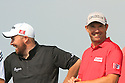 Shane Lowry (IRE) and Padraig Harrington (IRE) share a joke in during practice ahead of Abu Dhabi HSBC Golf Championship played at Abu Dhabi Golf Club 16-19 January 2014.(Picture Credit / Phil Inglis)