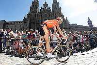 Juan Jose Oroz passes by the front of the Obradoiro of the Cathedral of Santiago de Compostela before the stage of La Vuelta 2012 between Santiago de Compostela and Ferrol.August 31,2012. (ALTERPHOTOS/Acero)